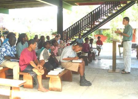 Marcus preaching at Alotau congregation